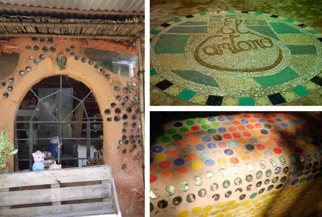 土や竹、ガラス瓶が使われた建物、モザイクアートのロゴなどの写真